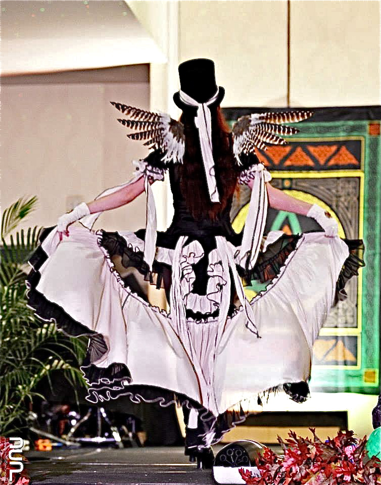 woman on runway in steampunk burlesque fairy costume by Accentuates Clothing
