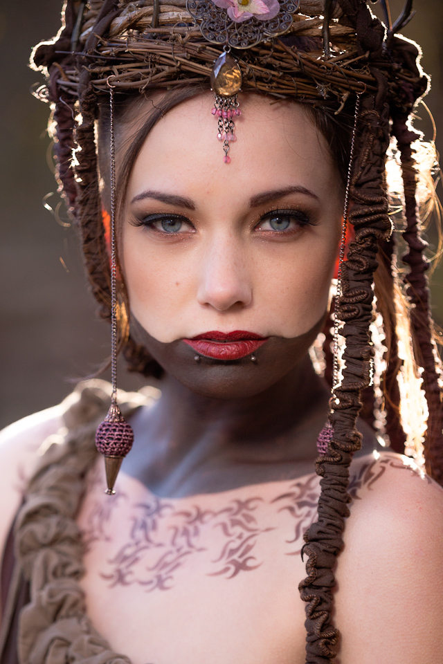 woman with dramatic tribal makeup and forest flower crown by Accentuates Clothing