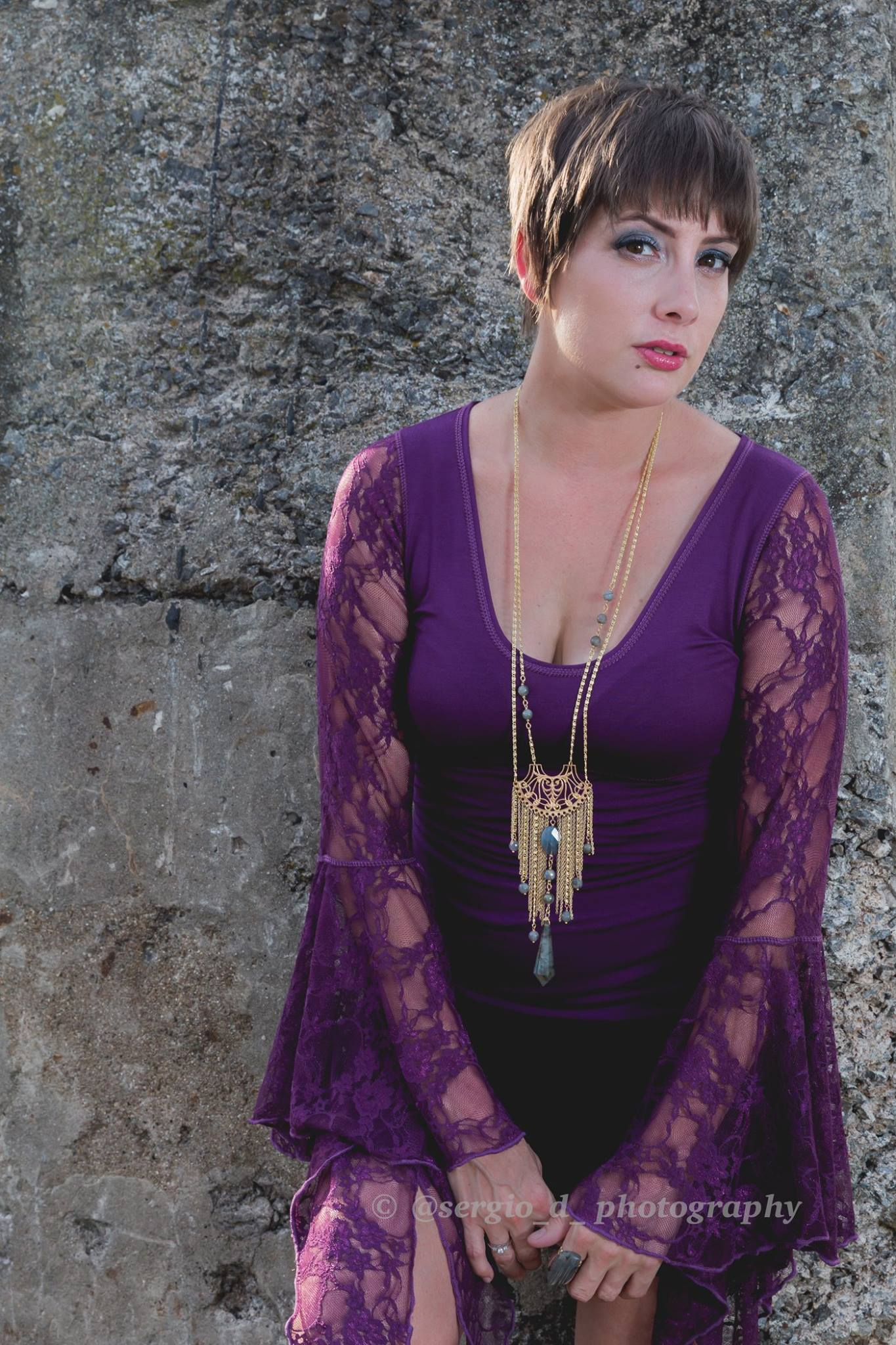woman in purple lace sleeve top by Accentuates Clothing