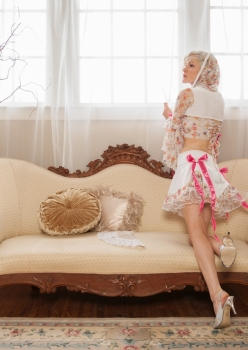 Woman in Let them eat cake Marie Antoinette inspired costume by Accentuate Clothing in Rococo French boudoir