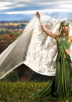 woman in field wearing meadow deva costume with giant veil by Accentuates Clothing