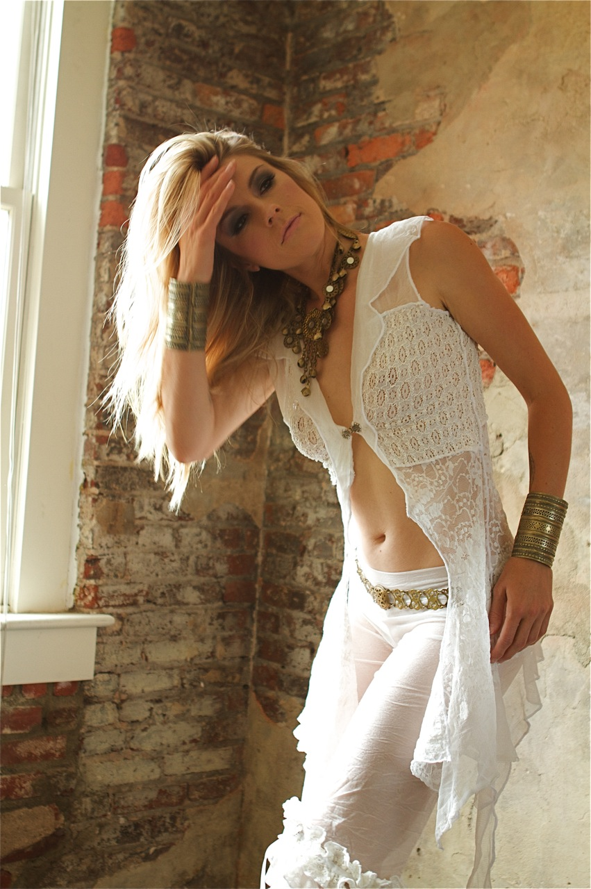 model in sexy white lace outift by Accentuates Clothing