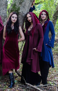 accentuates clothing slip dress and red and blue hooded jackets on women models