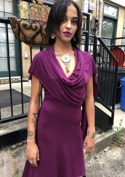 young woman modeling fashion in urban neighborhood