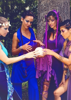 4 woman in elven fairy costumes with crystal ball