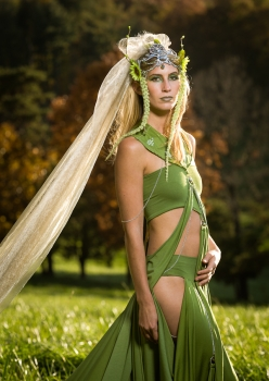 woman in field wearing meadow deva costume with giant veil headpiece by Accentuates Clothing
