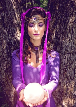 Woman in Fae Elven outfit by Accentuates Clothing with crystal ball